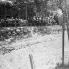 Camp-Trinity-Bar-717-Ranch-meal-time-on-the-Eating-Platform,-ca.-1940s